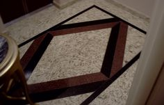 Projeto da Arquiteta Larissa Araujo Soares - Sigma Arquitetura.  Piso de Hall de Entrada.