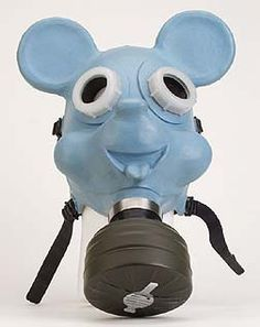 """Bill Barminski      """"Mickey Gas Mask""""      Latex rubber and cannibalized gas mask parts, 2001        One in a series of gas mask designs based on cartoon characters. Barminski created these for a multimedia installation titled Filter. Others in series include Fred Flinstone, Barbie, and Bozo the Clown. www.barminski.com"""