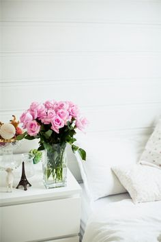 White bedding & pop of pink.