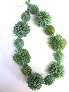 African Threads - Zulu necklace pom-poms  greens, $85.00 (http://www.africanthreads.ca/zulu-necklace-pom-poms-greens/)