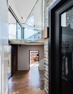 A bright and airy double-volume hallway. Glass Brick, The Design Files, Raw Materials, Natural Light, Entrance, Home And Family, Stairs, House Design, Living Room