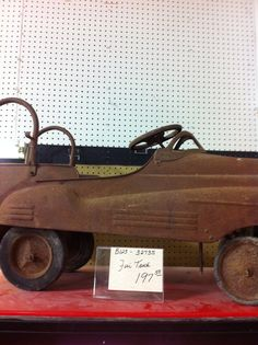 Rusty antique peddle fire truck at Jesse James Antique Mall we have 16 pedal cars