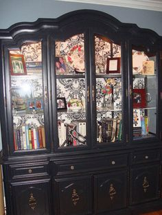 Your china cabinet painted black. I think this would look good with the inside painted or wall papered; with red and white and black pieces in it.