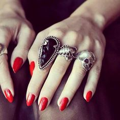red nails + silver rings
