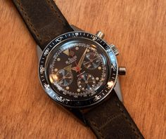 A 1960's era Le Jour 3 Register Chronograph with a black dial, luminous dot and triangular markers, and a 17-jewel, manual Valjoux 72 movement. (Store Inventory # 9356, listed at $1950).  #lejour #valjoux #72 #chronograph #racing #black #dial #tachymeter #watch #vintage #watches #classic #wristwatches #stawc