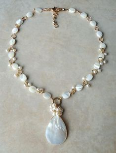 One of a kind chunky pearl necklace in crystals and black and dark gray pearls on gold chain