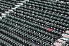 The red seat represents the longest Fenway homerun, hit by Ted Williams on June 9, 1946. The guy sitting in the seat also fell asleep and....Fenway Park #Boston #Redsox