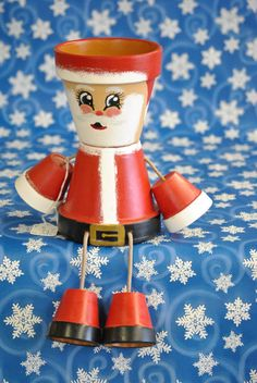 Santa is made of 2 4 inch pots with smaller for feet and hands, Hand painted so may vary little from picture, Makes unique Gift. Clay Pot Projects, Clay Pot Crafts, Diy Clay, Decor Crafts, Holiday Crafts, Painted Clay Pots, Painted Flower Pots, Hand Painted, Flower Pot People