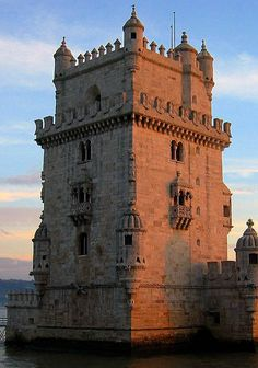 Torre de Belém (Belém Tower or the Tower of St Vincent) Santa Maria de Belém, Lisbon, Portugal... www.castlesandmanorhouses.com ... Torre de Belém (Belém Tower or the Tower of St Vincent) is a fortified tower, commissioned by King John II to be part of a defense system at the mouth of the Tagus river and a ceremonial gateway to Lisbon. It is a UNESCO World Heritage Site (along with the nearby Jerónimos Monastery) because of the significant role it played in the Age of Discoveries.