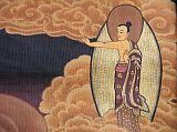 In the upper right corner of the painting outside the wheel, Buddha is standing with his left hand in a fearlessness mudra and with the index finger of the right hand pointing to the other side at the top left, pointing to the path out of the wheel.