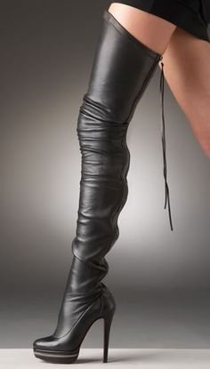 Thigh high black leather boots. Oh, my.