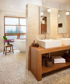 2. Reflect nature with materials. Natural textures like wood and stone breathe life into a bathroom. A pebbled tile floor feels amazing underfoot.    If a new floor is not in your budget anytime soon, treat yourself to a pebble bath mat.