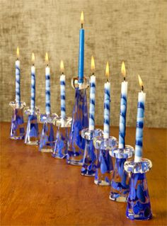 Custom Menorah using Wedding Breaking Glass - Custom glass blown art by Mazel Tov Glass - mazelmoments.com