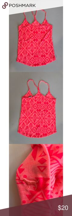 NWOT PINK tribal cami Brand new PINK razorback cami. In bright pink, with orangey tribal patterns. Super cute & perfect for spring and summer, or as pjs PINK Victoria's Secret Tops Camisoles