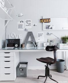 Love the typography. White walls. White desk. White board. Grey letters.
