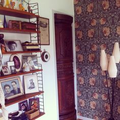 William Morris. Pimpernell in the dining area and livingroom. String shelving from the fifties.