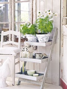 Shabby chic flower pot shelf arrangement