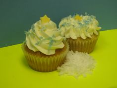 """Coconut Avalanche Cupcake Our coconutty cupcake (filled with a coconut cream and topped with a coconut buttercream) is perfect for fans of this tropical fruit--biting into this cupcake is like taking a trip to an island paradise!  Even more appropriate, the word derives from cocos, old Spanish for """"grinning face"""", which is what you'll be wearing as you indulge..."""