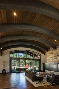 arched wood ceiling and large timber beams in this durango, co mountain home
