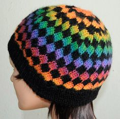 Estonian Rib Hat in Mini Mochi. Free pattern for fingering, good for scraps as you change colour every four rounds. Has doubled band, would be snug and warm