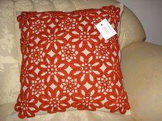 red crochet flower pillow
