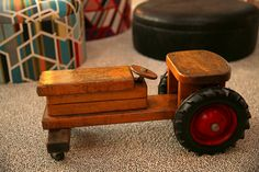 A circa 1960 wooden ride-on tractor by Community Playthings.