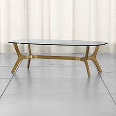 very elegant in person, could change top, but this might be perfect Elke Glass Coffee Table