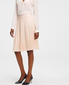 """Pretty pleats: with crisp lines, fresh color and just a hint of swing, our full pleated skirt puts a new spin on day to night dressing. Grosgrain waistband. Hidden side zipper with hook-and-eye closure. Lined. 25"""" skirt length; 24"""" lining length."""