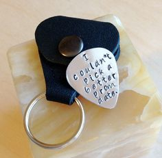 Stamped Guitar Pick with Leather Pouch  by BlueCornerCreasigns