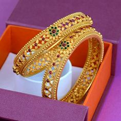 Multi color gold bangles. Red and green stones flower design gold bangles