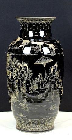 "BLACK GLAZED PORCELAIN VASE WITH GOLDEN MARKS Early 20th Century. H: 19.5"""