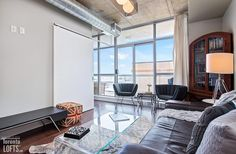Chelsea Lofts-1375 Dupont St #403 | Fab 1 bedroom + den with bright South city skyline views, floor to ceiling windows & full width balcony! | More info here: torontolofts.ca/chelsea-lofts-lofts-for-sale/1375-dupont-st-403-1 Concrete Column, Concrete Ceiling, Exposed Concrete, Soaker Tub, Floor To Ceiling Windows, Lofts, Balcony, Den, Locker Storage