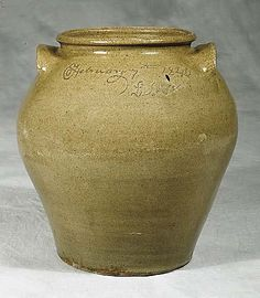 Rare and important Edgefield SC 'Dave' alkaline-glazed stoneware storage jar, Edgefield District, SCcirca 1840five-gallon ovoid jar with ear-shaped handles and rolled rim; inscribed on one side: Mr Miles Dave; opposite side inscribed: February 7th 1840/L. Miles; inscription flanked by five dots indicating capacity of jar, and double slash marks.
