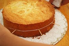 6 Tips on How to Cut a Cake Layer in Half - this worked wonderfully with slicing the boys' cakes yesterday!