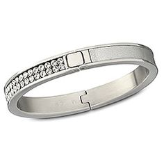 This stainless steel hinged bangle with clear Crystal Mesh and silver calfskin leather adds a touch of sophisticated gloss to any outfit. This statement creation is bold and beautiful!