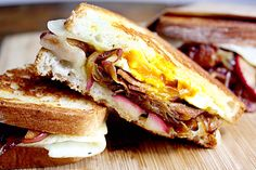 bacon and egg grilled cheese with caramelized onions and apples