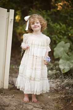 Adorable Katie is wearing her heirloom dress design by Mela Wilson, for order write to mela.wilson2@comcast.net