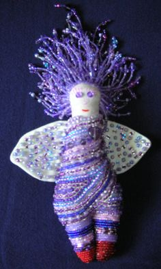 Purple Angel with Red Shoes. Free-form bead embroidery on doll, made and designed by Ann Blackwell,  DragonFibre Studios.