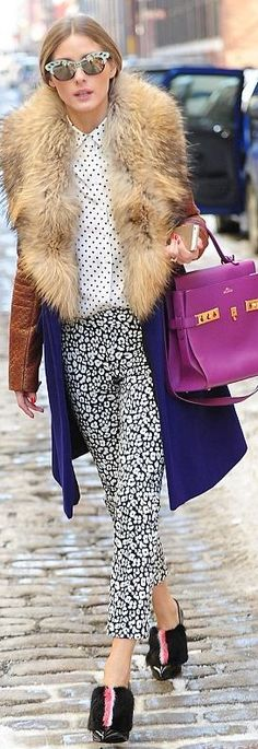 Who made Olivia Palermo's blue coat, purple handbag, black boots, print sunglasses, and white polka dot button down shirt? Coat – Diane von Furstenberg Shoes – Fendi Sunglasses – Wunderkind Purse – Delvaux Shirt – Tibi Pants – Banana Republic