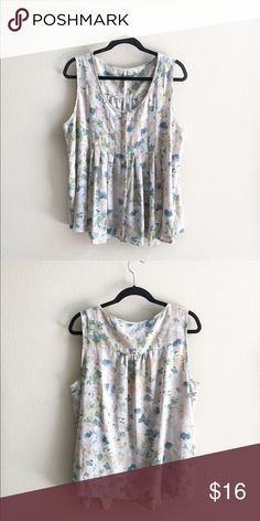 "Floral Tank Blouse Beautiful polyester tank blouse with a grayish cream base and teal, peach and yellow flowers. It's a button up with chic pintuck pleating. The bust measures 24"" flat and it is 28"" long. LC Lauren Conrad Tops Blouses"