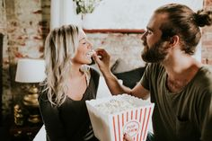 This sweet and casual pillow fight photo shoot is super fun and features fresh popcorn, the couple sharing a good read, and tons of kisses!