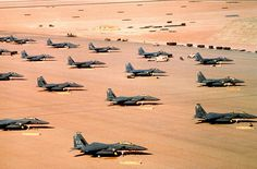 F-15E Eagle fighter aircraft of the 4th Tactical Fighter Wing Seymour Johnson Air Force Base N.C. are parked on an air field during Operation Desert Shield.