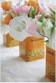 """Tea tins as centerpieces... going for a """"British Colonial"""" feel...thinking tea tins would play in nicely! Peach tea perhaps!"""