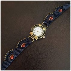 This handcrafted micro macrame watch is fully functional and is made with a quartz brand watch face, genuine red jasper beads, navy blue polyester cord, and other various bronze and glass beads. It is adjustable to fit wrist sizes 16.3 cm to 21 cm. Back of watch face is stainless
