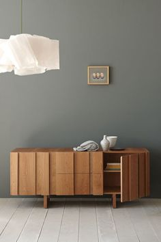 slate color, modern light fixture, wood credenza