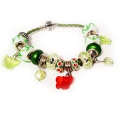 """Red and green butterflies inspired this cute European style charm bracelet which features crystal spacer beads and a lime green leather clasp band. For a limited time only 99¢ on your entire order PLUS get 25% off your entire order with coupon code HURRY25%OFF  www.mycharmstore.com www.facebook.com/mycharmstore """"like"""" us to get updates on new products, discounts and contests coming soon!"""