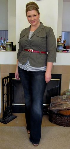 Green jacket, Stripe shirt, jeans, red belt.