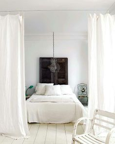 doors for bed head - pillow rests in a white room