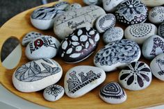 pebbles from Portugal, hand painted by Sabine Ostermann