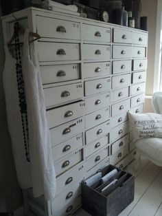This piece is adorable. I like the drawers and handles. Reminds me of like a postmaster cabinet.